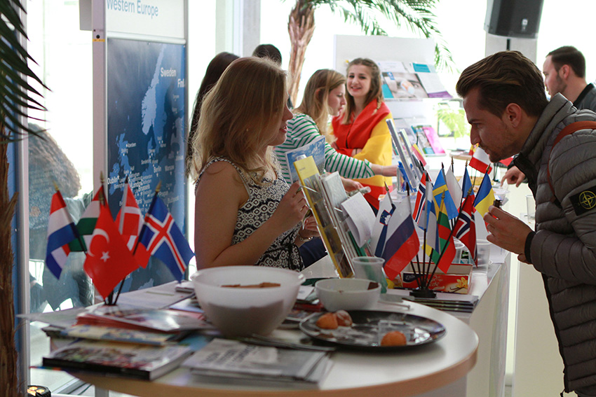 Foreign exchange students promoting their regions and home universities at the InternationalFair.