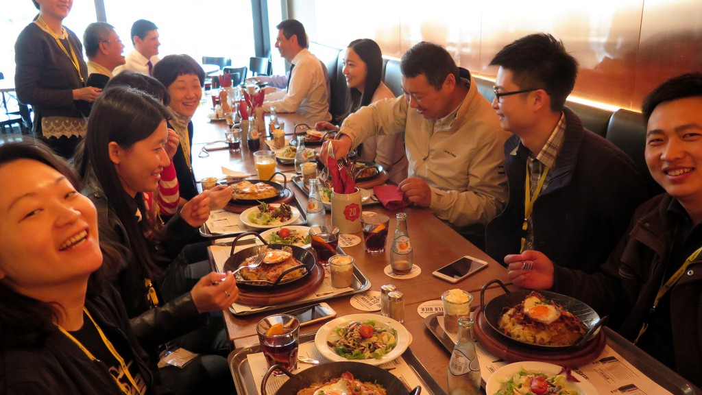"The guests from Hong Kong were invited to taste traditional Swiss cuisine such as ""Rösti""."