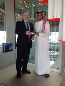 Khaldoun Dia-Eddine handing over a gift to the ceremony director at Qatar foundation.